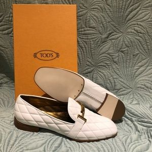 Tod's White quilted loafers with gold accents